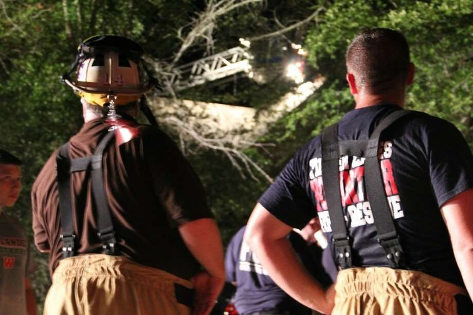 A fire ladder was extended over the highest point of the house to douse encroaching flames.