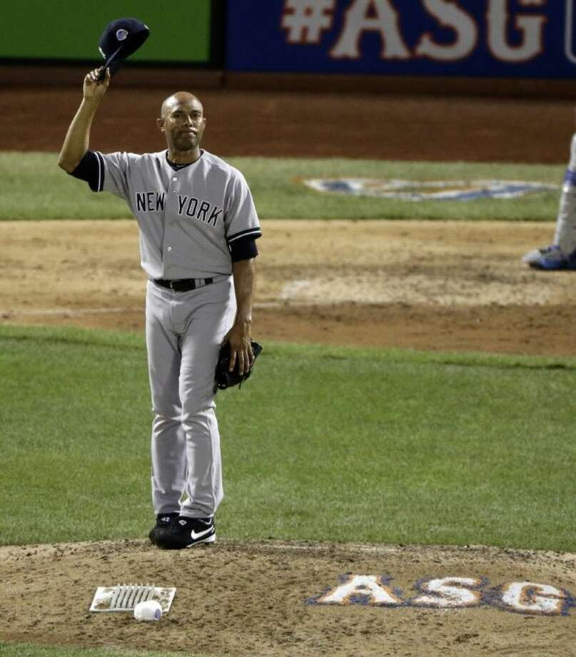 The American League's Mariano Rivera of the New York Yankees acknowledges the crowd as he is introduced during the eighth inning of the All-Star Game on Tuesday in New York. Photo: Frank Franklin II