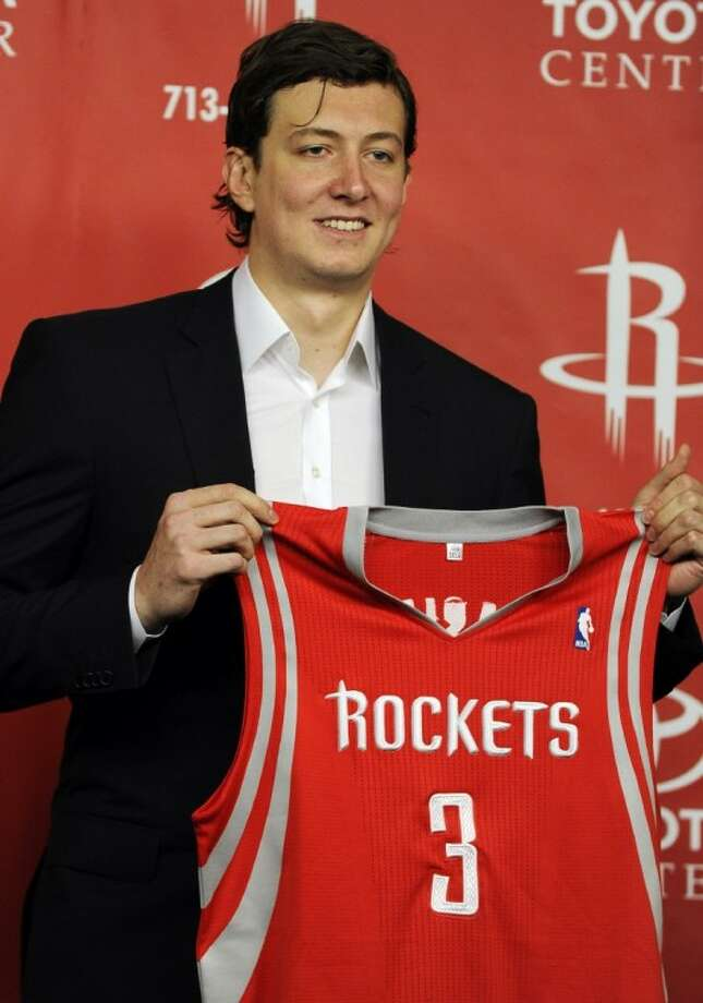 Houston Rockets center Omer Asik poses with his new jersey during a news conference Thursday in Houston. Photo: Pat Sullivan