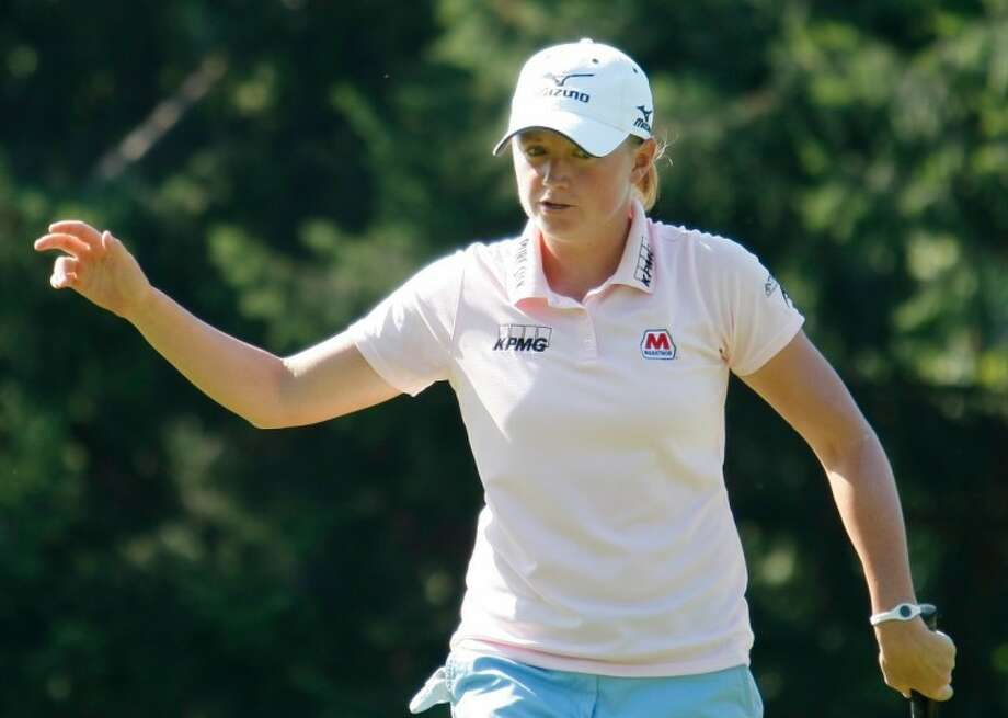 Stacy Lewis reacts as she plays on the 17th hole during the first round of the Evian Masters on Thursday in Evian, France. Photo: Claude Paris