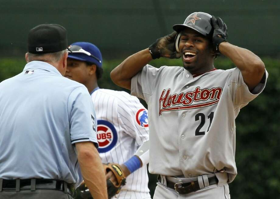 Houston Astros center fielder Michael Bourn reacts after second base umpire Dale Scott called him out stealing second against the Chicago Cubs on Saturday in Chicago.
