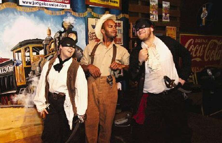 """Playing a scene for laughs in the family-friendly melodrama, """"The Haunting of Bella De Ghosse"""" are, from left, Star Hinson, Gregory McGregor and Shane Manning."""
