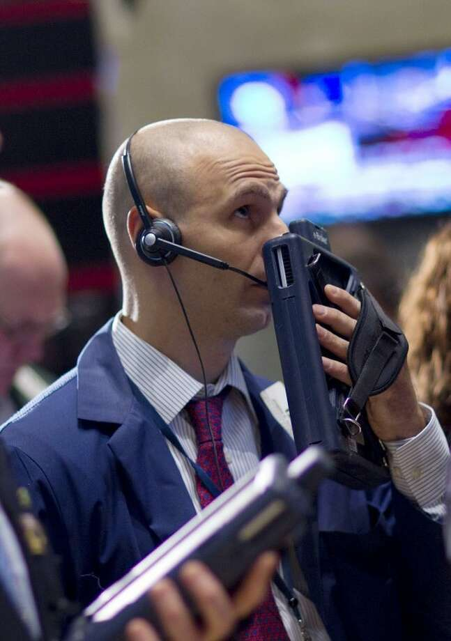 A trader works on the floor of the New York Stock Exchange on Wednesday in New York. With no clear sign of what will invigorate growth, there is mounting fear on Wall Street that the U.S. risks sliding into a long-term economic coma. Photo: The Associated Press