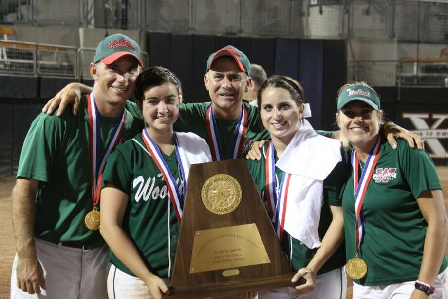 The Woodlands coaches, from left, Tim Borths, Richard Jorgensen and Paula Miller celebrate with seniors, from left, Brooke Riemann and Kelsey Jolly after the Lady Highlanders won the UIL Class 5A state championship in June. Photo: John Mann