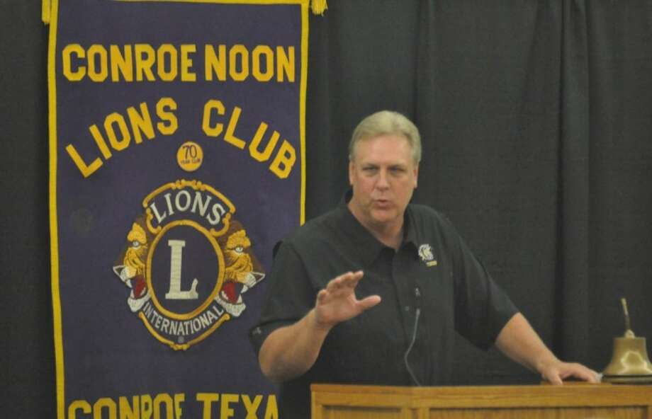 Conroe football coach Roger Holtkamp speaks during the 36th annual Buddy Moorhead District 14-5A Pigskin Preview sponsored by the Conroe Noons Lions Club at the Lone Star Convention Center on Wednesday.
