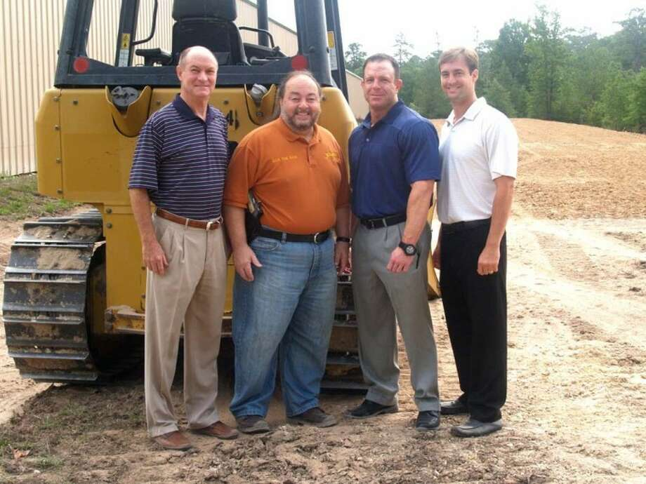 From left, Neal Brussell, Danny Benois, Steve Walton and Rhett Bunce pose at the site of the expansion of Shooter's Station.