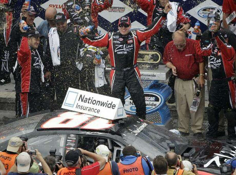 Kyle Busch celebrates after winning the NASCAR Nationwide Series New England 200 auto race at New Hampshire Motor Speedway in Loudon, N.H., Saturday. / AP