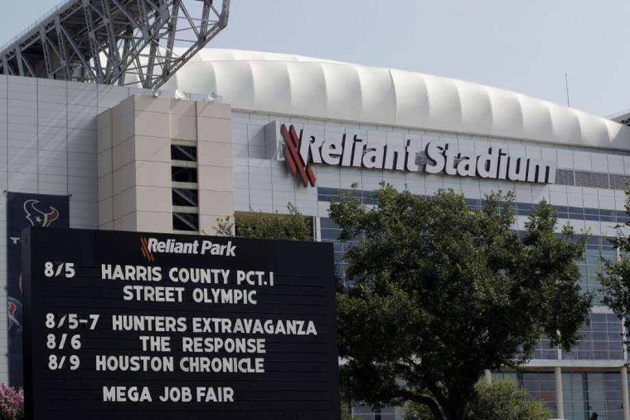 A sign outside Reliant Stadium lists the upcoming prayer event, The Response: a call to prayer for a nation in crisis Tuesday in Houston. Texas Gov. Rick Perry organized what seemed like a slam-dunk event for a politician in a state where religion and politics walk hand in hand: He would fill Houston's Reliant Stadium with fellow believers in a seven-hour session of Christian atonement. But this weekend's prayer rally could be political double-edged sword now that he is eyeing a run for the White House. Photo: David J. Phillip