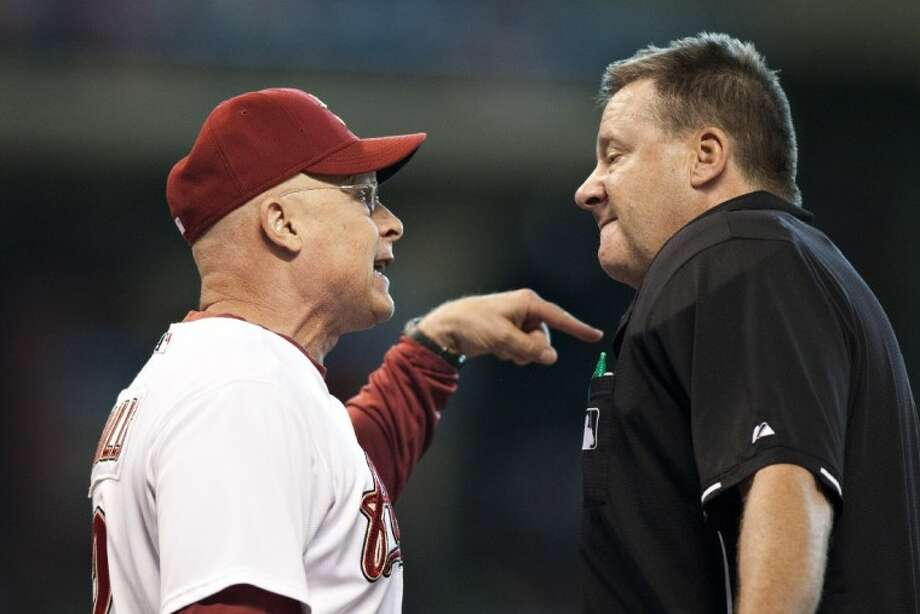 Houston Astros' manager Brad Mills, left, argues a call with home plate umpire Gary Cederstrom, right, against the Milwaukee Brewers, Saturday in Houston. Photo: Jonathan Eilts