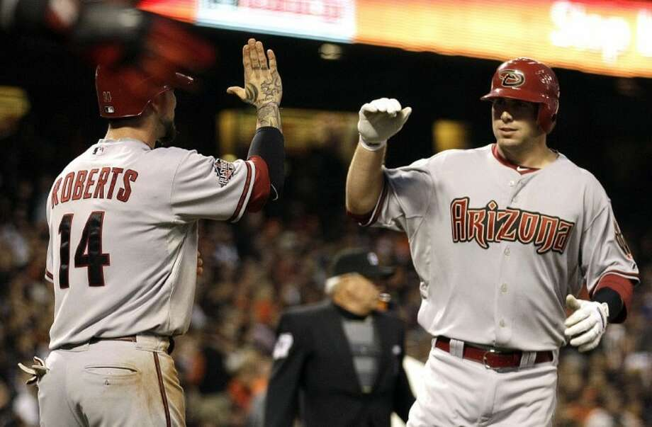 Arizona Diamondbacks' Paul Goldschmidt, a 2006 graduate of The Woodlands High School, is congratulated by Ryan Roberts after Goldschmidt hit a two-run home run off San Francisco Giants' Tim Lincecum last Tuesday in San Francisco. Photo: Ben Margot