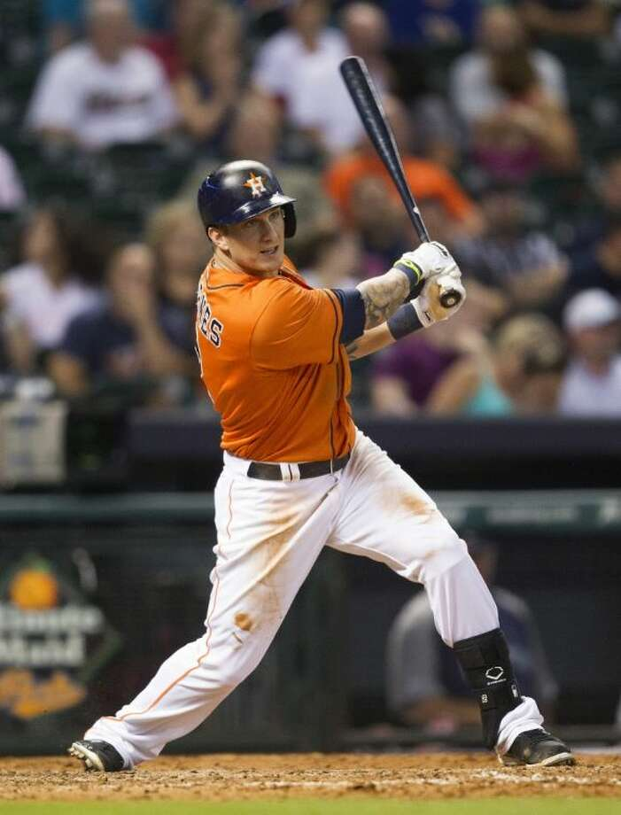 The Houston Astros' Brandon Barnes watches his double in the eighth inning to complete the cycle on Friday against the Seattle Mariners in Houston. Photo: Bob Levey