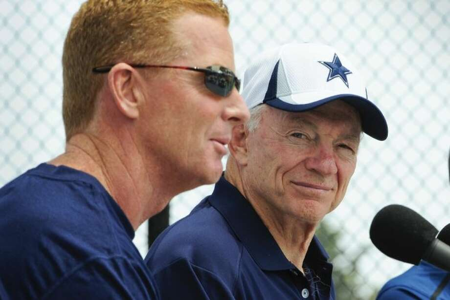 Dallas Cowboys owner Jerry Jones, right, watches as coach Jason Garrett, left, answers a question at a news conference. Photo: Gus Ruelas