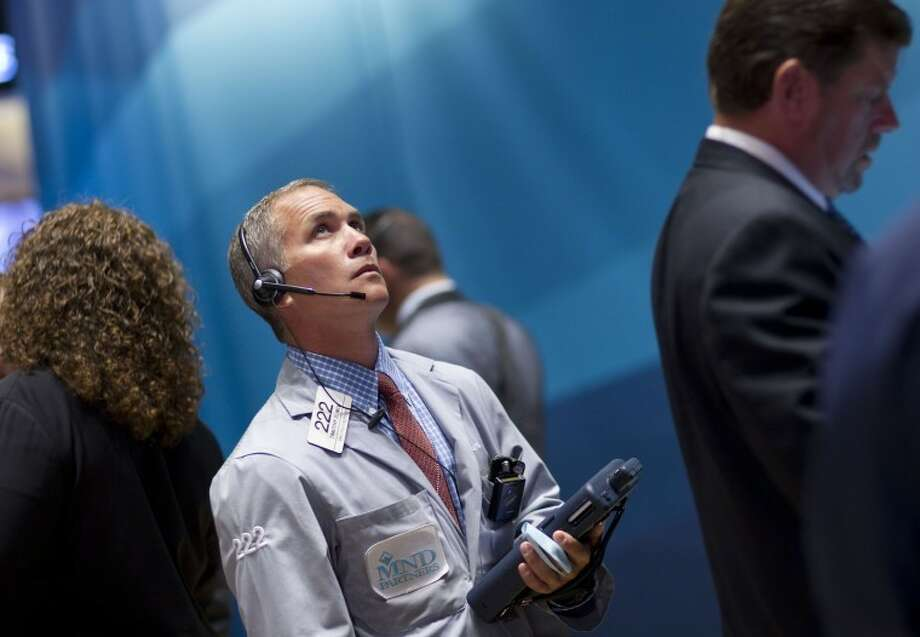 Traders work on the floor of the New York Stock Exchange on Monday in New York. Photo: Associated Press