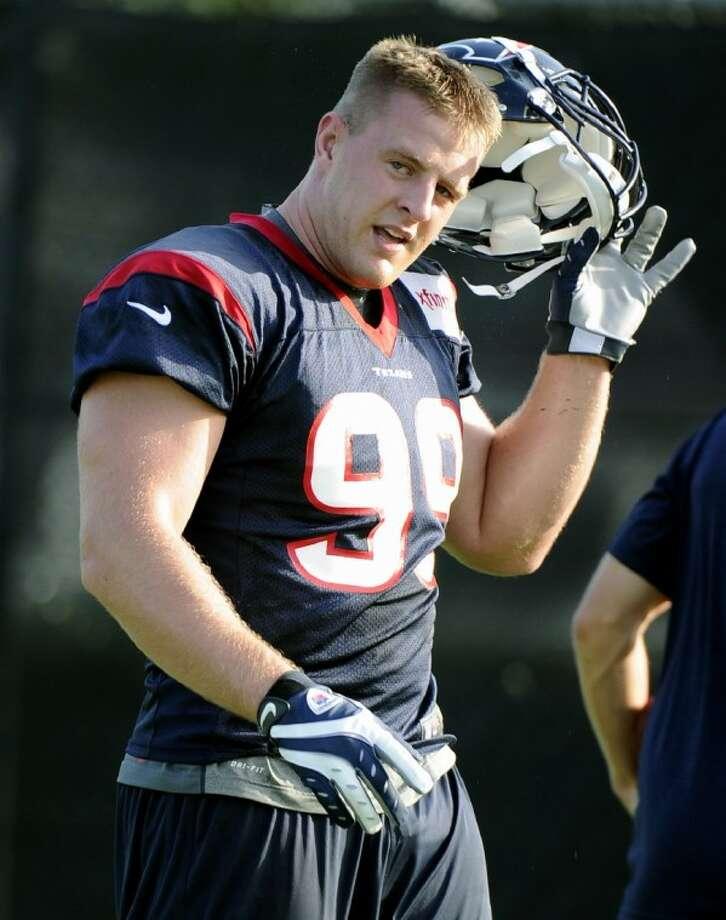 The Houston Texans' J.J. Watt takes his helmet off during training camp Sunday in Houston. Photo: Pat Sullivan