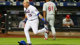 NEW YORK, NEW YORK - SEPTEMBER 22:  Asdrubal Cabrera #13 of the New York Mets celebrates after hitting a game winning walk-off three run home run in the bottom of the twelfth inning against as Edubray Ramos #61 of the Philadelphia Phillies walks off the field at Citi Field on September 22, 2016 in the Flushing neighborhood of the Queens borough of New York City.  (Photo by Mike Stobe/Getty Images)