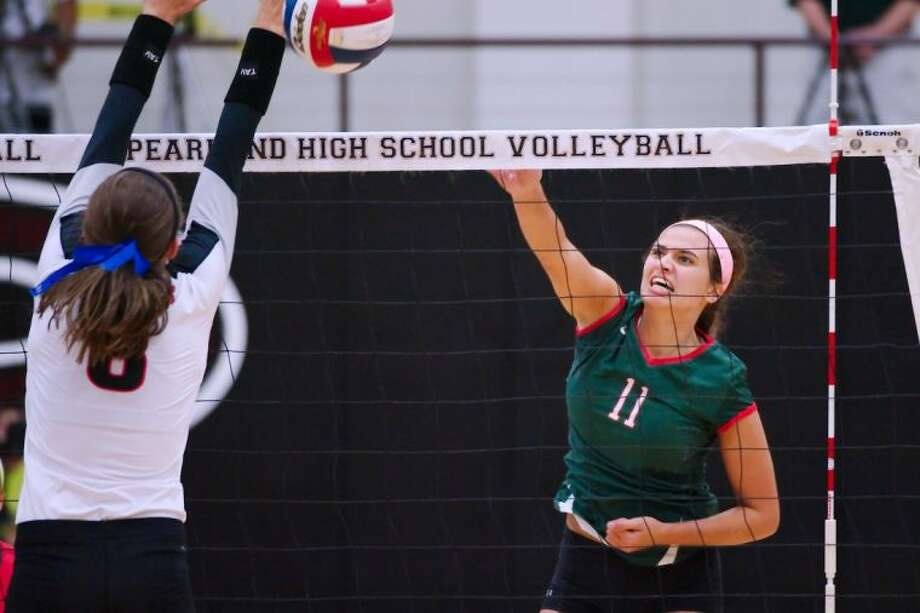 The Woodlands' Courtney Quinn drives a kill shot past Coppell's Kylie Pickrell during the Texas Invitational final on Saturday in Pearland.