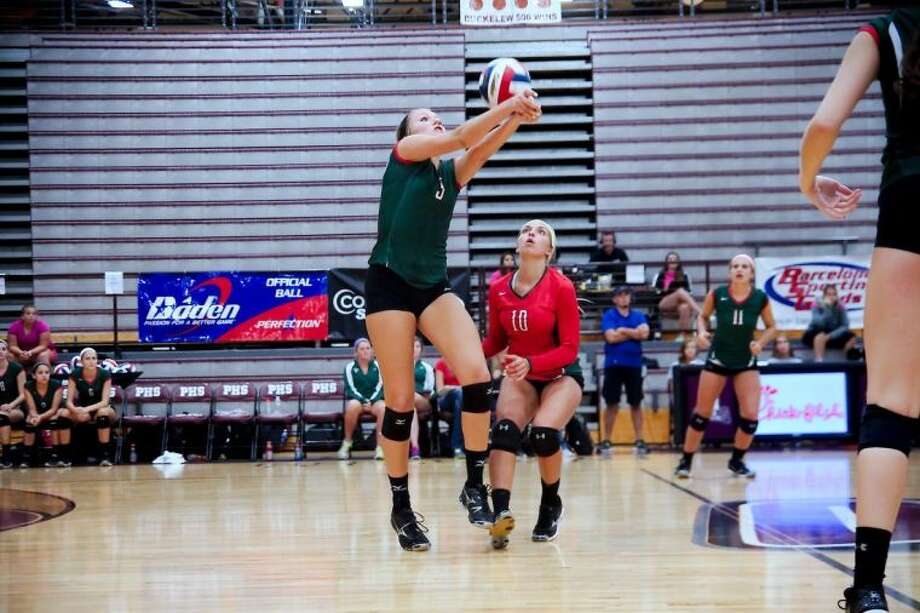 The Woodlands' Madison McDaniel, pictured playing in the Texas Invitational, helped the Lady Highlanders remain unbeaten Thursday with three victories in the Magnolia Tournament.