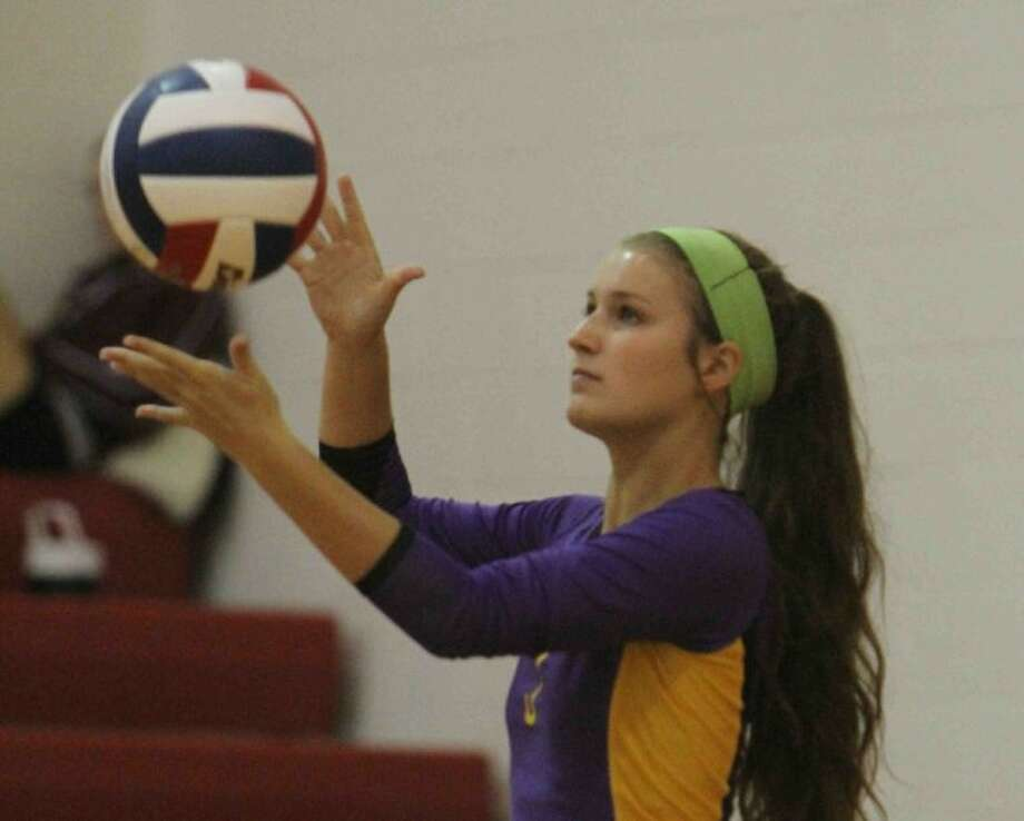 Lauren Beam serves the ball during a match at the Katy/Cy-Fair Tournament on Thursday at Cy Woods High School. To view or purchase this photo and others like it, visit HCNpics.com. Photo: Staff Photo Jason Fochtman
