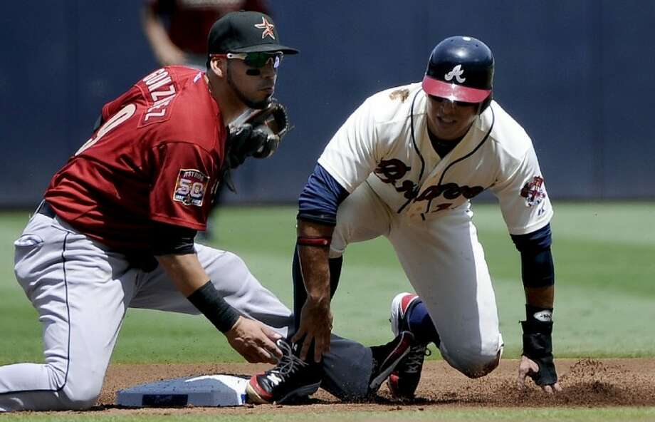 Atlanta Braves' Martin Prado safely steals second base in front of Houston Astros shortstop Marwin Gonzalez during the first inning of their baseball game at Turner Field, Sunday, in Atlanta. Photo: Dave Tulis
