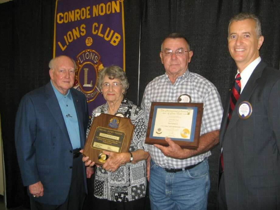 Members for Life - The Conroe Noon Lions Club honored Life Memberships to club members Almeta Albertson,center left, and Paul Kleinpeter, center right, each qualified with a combination of age and club tenure. Making the presentations was Past International Director Don A. Buckalew, left, and Club President Rich Sproba, right.
