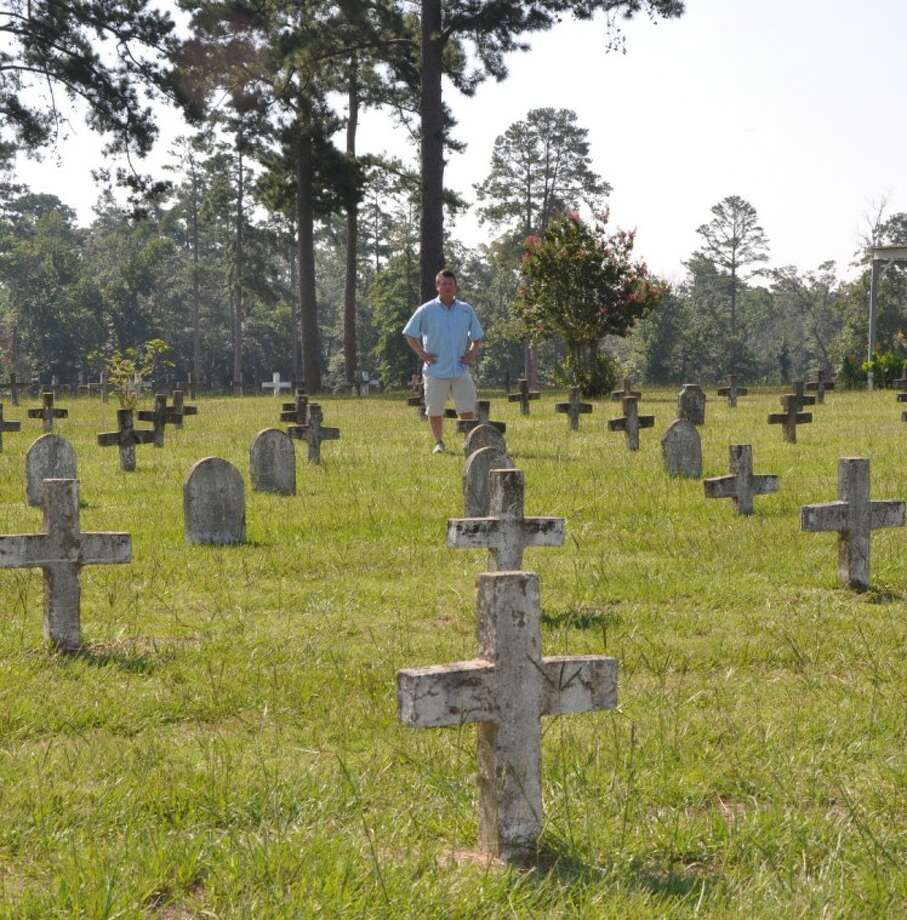 """Dr. Frank Wilson, an SHSU doctoral graduate and assistant professor at Indiana State University, is writing a book about the prison cemetery in Huntsville. He calls the grounds """"America's common ground"""" found among the headstones on a quiet hill on Bowers Boulevard, just a few blocks from Sam Houston State University and the Huntsville """"Walls"""" Unit."""