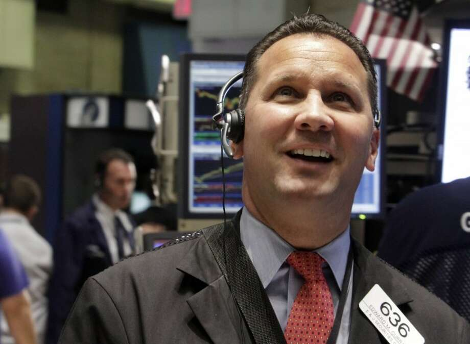 Trader Edward Curran smiles as he works on the floor of the New York Stock Exchange Thursday. Photo: Associated Press
