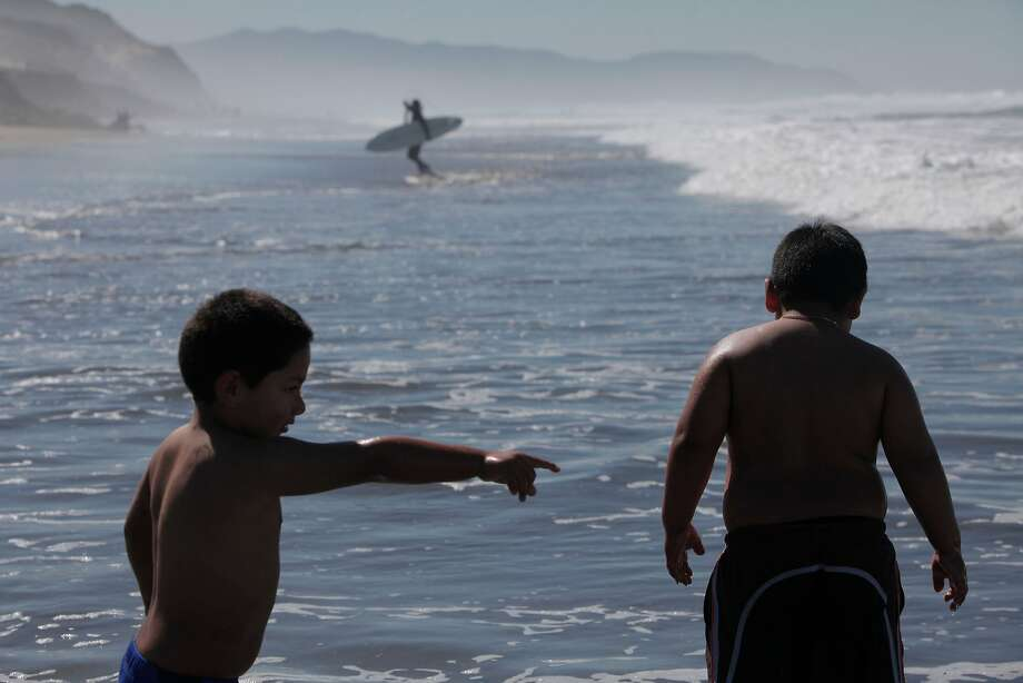 From left: Rafel Martinez, 4, and Augustin Martinez, 5, play in the surf at Ocean Beach on Saturday, Sept. 24, 2016 in San Francisco, Calif. Photo: Gabriella Angotti-Jones, The Chronicle