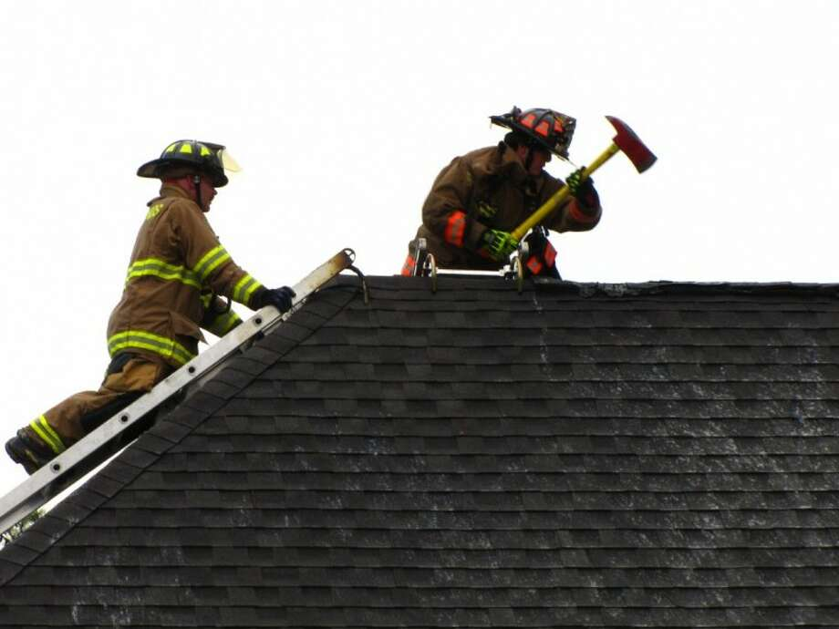 Firefighters worked to contain an attic fire in Bender's Landing believed to have been caused by a lightning strike Sunday afternoon.