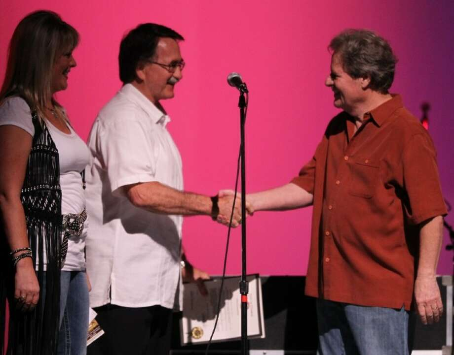 Debbie Glenn and Conroe Mayor Webb Melder congratulate Delbert McClinton in August at the Crighton Theatre. Melder proclaimed Aug. 6 Delbert McClinton Day in Conroe. McClinton's concert closed out the 2011 Sounds of Texas Music Series.