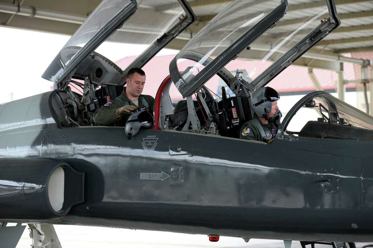 """U.S. Air Force Capt. Joshua """"Buffer"""" Smith (left) and U.S. Air Force Reserve Maj. Ryan """"Bolt"""" Watson prepare to leave their T-38C Talon after a training mission Thursday Sept. 15, 2016."""