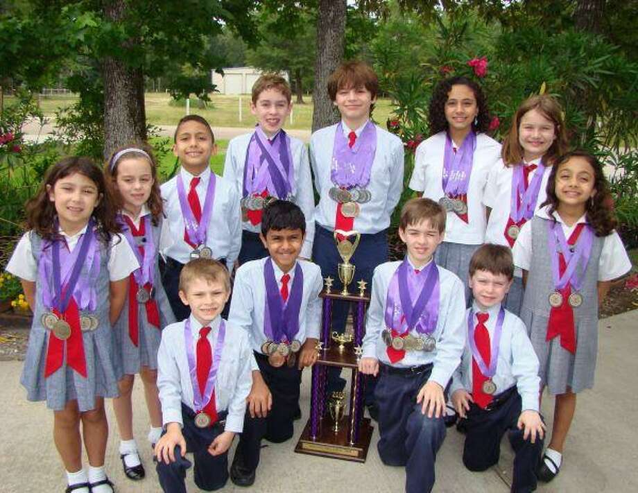 Rubicon Academy students, back row from left, Nikki Hart, Jennifer Baker, Adam Mobarak, Sean Baker, Devon Douglis, Mariam Mobarak, Isabel Perez and Asiyah Mobarak, and, front row from left, Michael Milam, Shray Mittal, Matthew Baker and James Schillinger brought home the first-place trophy from the Private School Interscholastic Association State Meet May 1 at Texas Christian University.