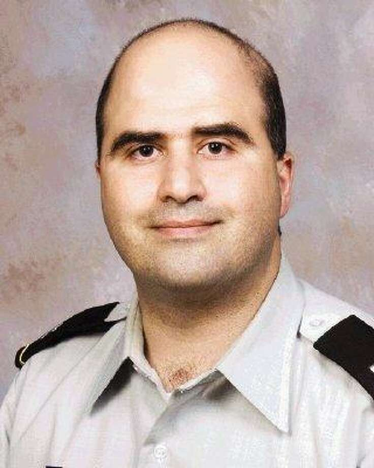 The 2007 file photo provided by the Uniformed Services University of the Health Sciences (USUHS) shows Nidal Malik Hasan when he undertook the Disaster and Military Psychiatry Fellowship program. / AP2007