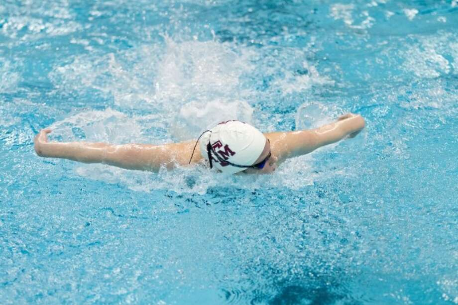 Texas A&M swimmer Camille Adams placed fifth in the finals of the 200-meter butterfly event at the London Olympics, the highest finish of any A&M swimmer participating. Adams grew up in the Woodlands and swam with The Woodlands Swim Team for several years.