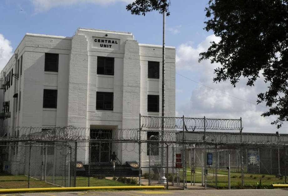 "The gates at the Texas Department of Criminal Justice Central Unit stand open Thursday in Sugar Land. The 102-year-old minimum security prison in suburban Houston is now more valuable as a land development site instead of a drain on the Texas state budget. It will continue to live on in the words of legendary early 20th century blues singer Huddie Ledbetter, better known as Leadbelly, a one-time inmate here who referred to the prison in his version of the classic song ""Midnight Special."" Photo: Pat Sullivan"