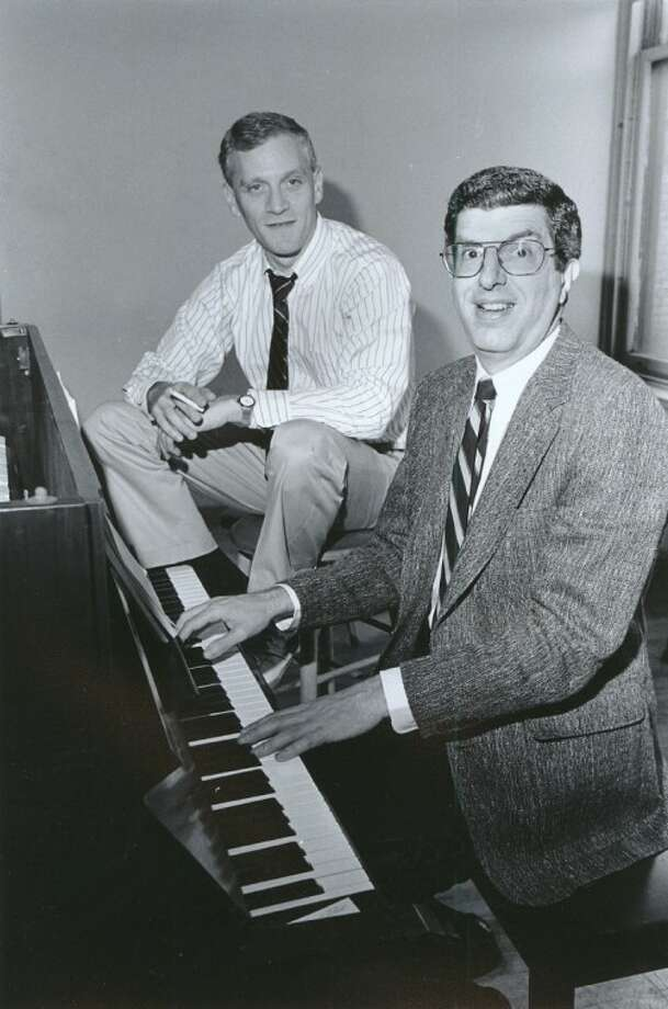 """This Sept. 9, 1986 file photo shows composer Marvin Hamlisch, right, at the piano with lyricist Howard Ashman in New York. Hamlisch, a conductor and award-winning composer best known for the torch song """"The Way We Were,"""" died Monday in Los Angeles. He was 68. Photo: NANCY KAYE"""