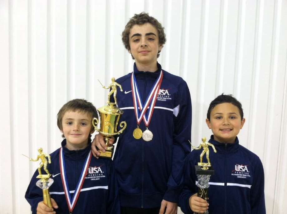 From left, Behr Crouse, Wolfe Crouse and James Kehoe show off their trophies from the Gulf Coast Division Championships. The trio recently represented the U.S. at the Youth/Cadet International Fencing Festival in Cancun, Mexico.