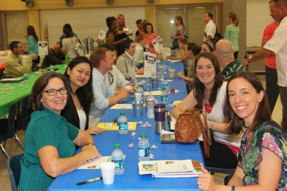 Conroe Independent School District hired more than 450 teachers for the 2013-14 school year. Teachers attended an orientation last week where all the principals joined them for lunch.