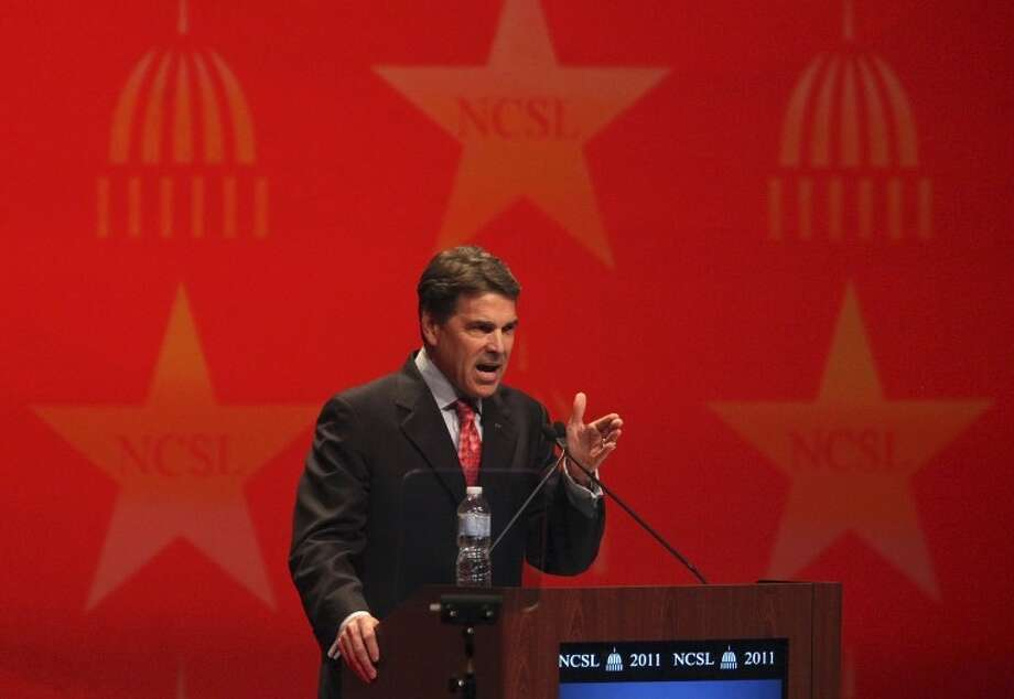Texas Gov. Rick Perry speaks at the National Conference of State Legislatures Legislative Summit at the Henry B. Gonzalez Convention Center in San Antonio on Wednesday. Photo: Associated Press