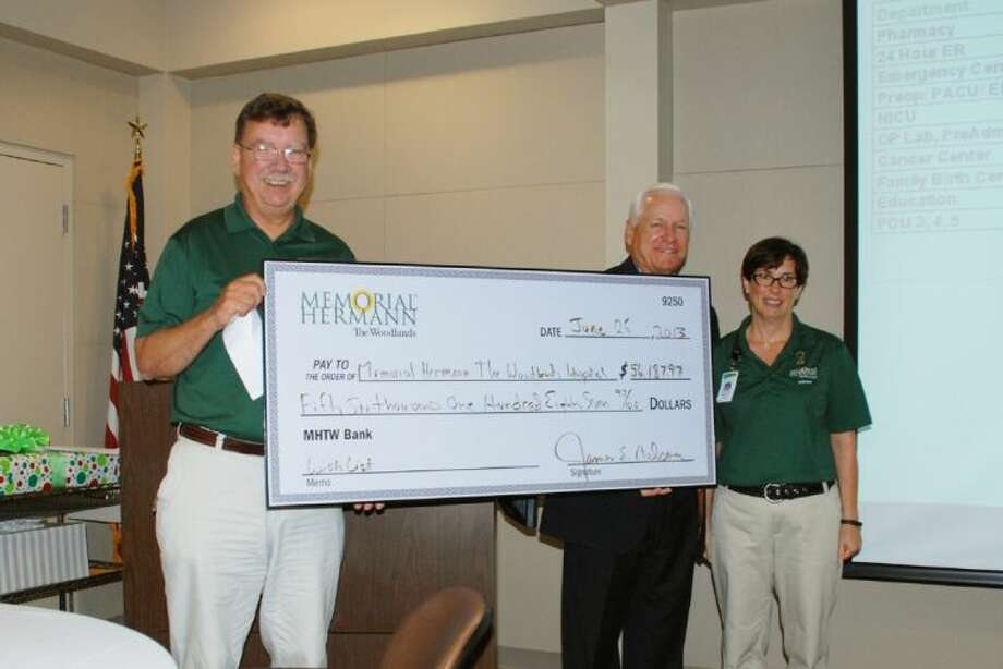 Pictured (left to right): Holding the annual Wish List check is Jim Nelson with Memorial Hermann The Woodlands CEO Steve Sanders and Barbara Giannotti.