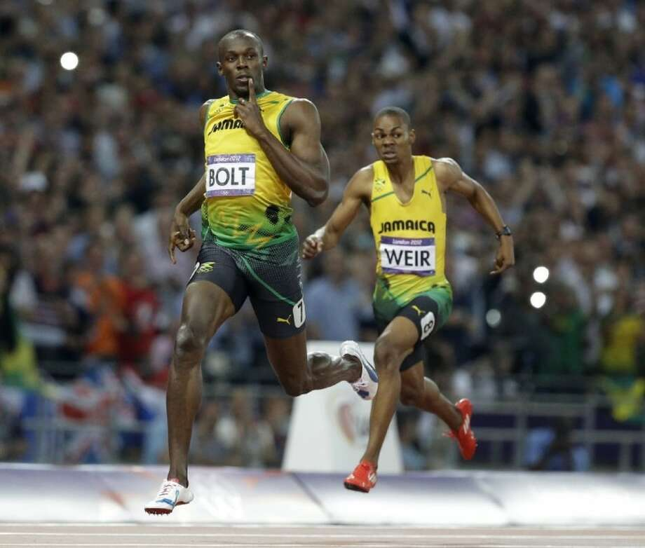 Jamaica's Usain Bolt crosses the finish line to win the men's 200-meter final Thursday in the Olympic Stadium at the Summer Olympics in London. Photo: Lee Jin-man