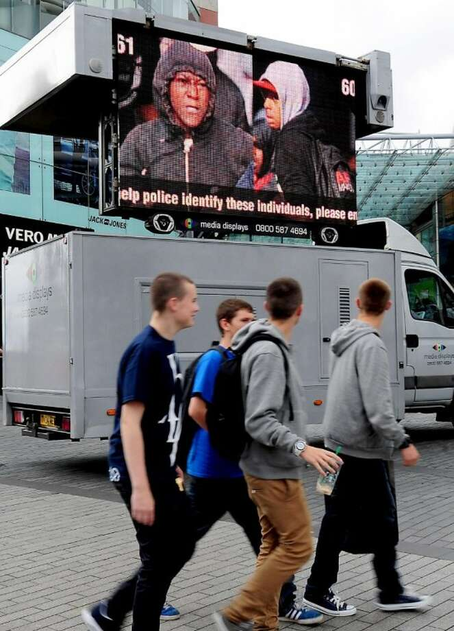 West Midlands Police appeal to the public by displaying pictures of suspected rioters outside the Bull Ring shopping centre in Birmingham, England, Friday. Photo: Rui Vieira