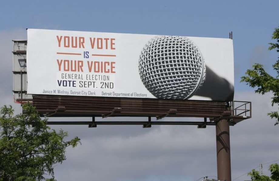 One of the billboards seen on Tuesday promoting Detroit's upcoming general election offered up some erroneous information about when to go to the polls. Photo: Carlos Osorio