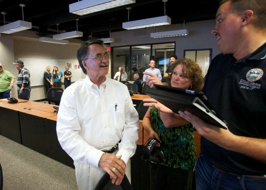 City of Conroe network administrator Damien Tijerina, right, and IT Manager Pam Cobb tell Mayor Webb Melder more about some of the innovative features of the city of Conroe's newly remodeled Emergency Operations Center on Wednesday at City Hall.