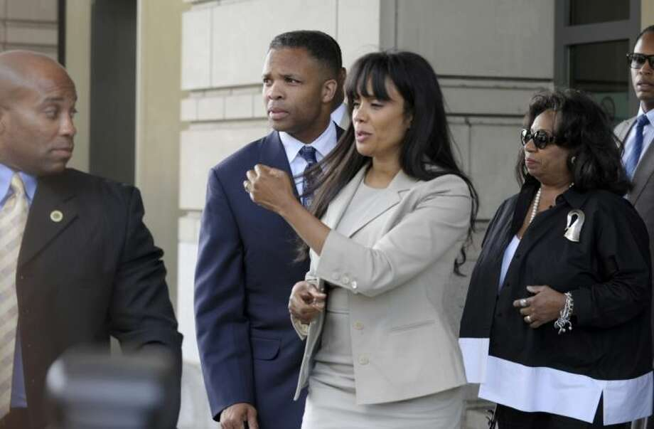 Former Illinois Rep. Jesse Jackson Jr., and his wife Sandra, leaves federal court in Washington, Wednesday.