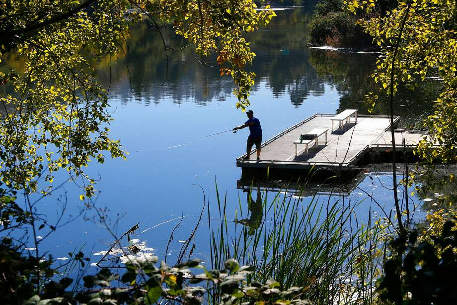 Casey Gallagher of Oakland fishes Lake Temescal in Oakland, California on Sat. Sept. 24, 2016, as temperatures soar throughout the Bay Area. Photo: Michael Macor / The Chronicle