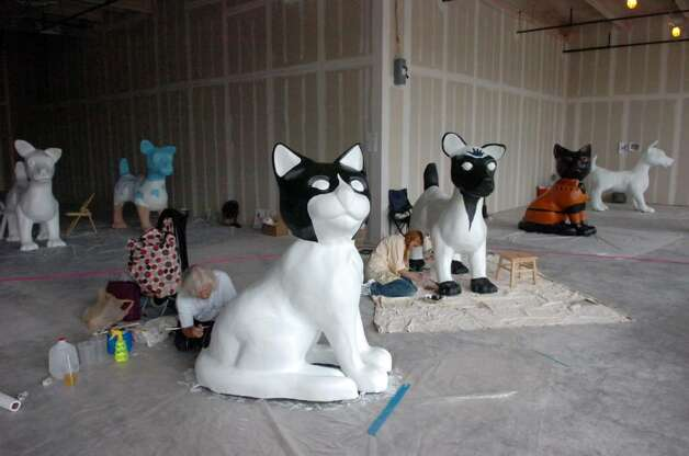 "Artists are working on the twenty-three dogs and seventeen cats that have arrived at the Artist's Studio at 1 Landmark Sq in Stamford Downtown Monday morning, May 3, 2010. The animals are for the DSSD's upcoming Summer sculpture exhibit, ""It's Reigning Cats & Dogs."" Photo: Keelin Daly / Stamford Advocate"