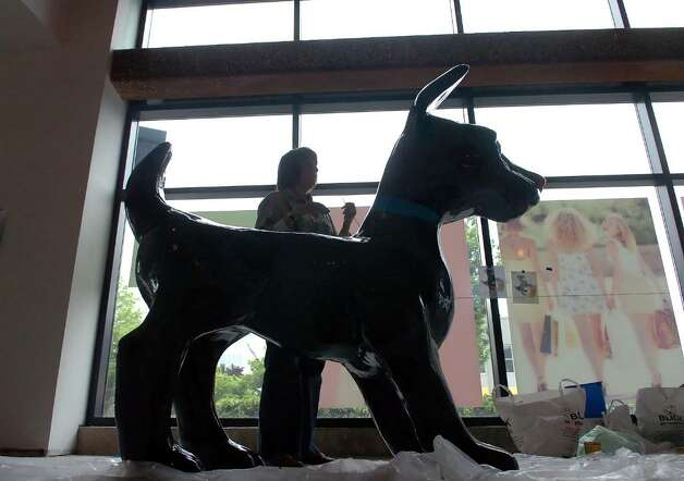 "Jody Silver's ""Top Dog"" takes shape at the Artist's Studio at 1 Landmark Sq in Stamford Downtown Monday morning, May 3, 2010.  Silver joins other artists working on the twenty-three dogs and seventeen cats that have arrived for the DSSD's upcoming Summer sculpture exhibit, ""It's Reigning Cats & Dogs."" Photo: Keelin Daly / Stamford Advocate"