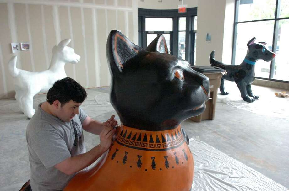 "David Macharelli adds detail to his ""Cat's Amphora"" at the Artist's Studio at 1 Landmark Sq in Stamford Downtown Monday morning, May 3, 2010.  Macharelli joins other artists working on the twenty-three dogs and seventeen cats that have arrived for the DSSD's upcoming Summer sculpture exhibit, ""It's Reigning Cats & Dogs."" Photo: Keelin Daly / Stamford Advocate"