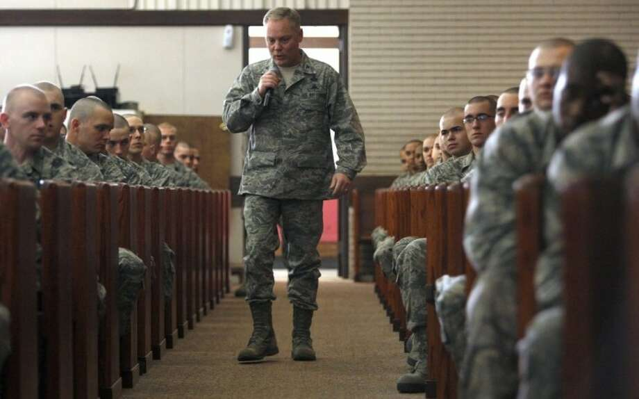In this March 2, 2012 photo, Air Force Col. Glenn Palmer, commander of the 737th Training Group at Lackland AFB, speaks to trainees in San Antonio. Officials tell The Associated Press that the Air Force has relieved Palmer, a top commander at Lackland Air Force base from his position in the wake of wake of a widening sex scandal. Photo: William Luther