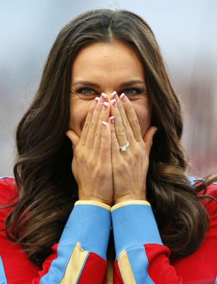 Russia's Yelena Isinbayeva reacts as she stands on the podium after receiving the gold medal in the women's pole vault on Thursday at the World Championships in Moscow. Photo: Alexander Zemlianichenko